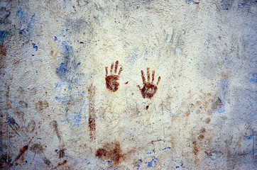 Mark of hands on a wall