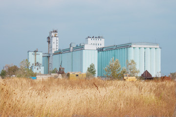Grain elevator rises among the steppe