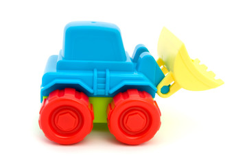 Colorful toy tractor over white