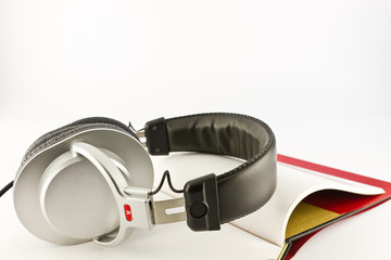 Headphone on open book