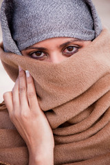 Muslim, Islamic woman: covering face with shawl or veil