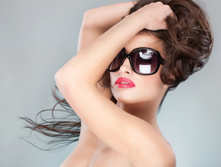 Pretty woman with long hair and sun glasses