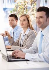 Cheerful businessteam listening presentation