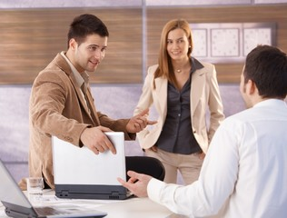 Young businessteam talking in office smiling