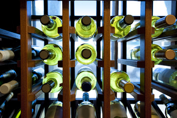 Fototapete - Wine bottles in wooden rack
