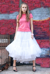 girl in white skirt and pink T-shirt
