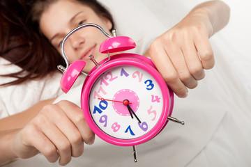 beautiful woman  and alarm clock