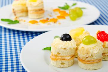 Plate full of tasty mini cakes