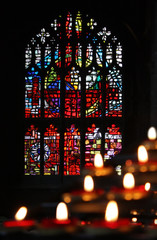 Candles and stained glass in the church