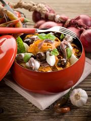 red tagliatelle with mozzarella, anchovies and black olives