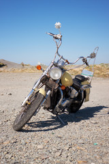 Old motorcycle is in a vacant lot autumn day