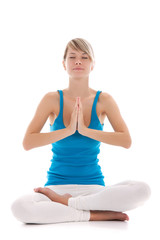 Portrait of a young healthy woman doing yoga exercises