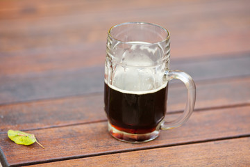 mug with dark beer standing on the table