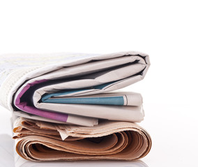 Coloful Newspapers on white background with copy space