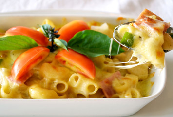 Delicious macaroni with cheese and  tomato
