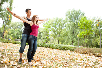 couple with outstretched arms