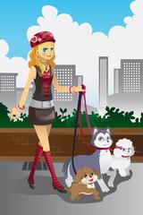 Girl walking her dogs