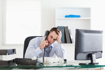 Businessman trying to solve a problem on the phone