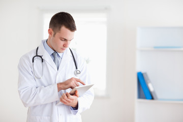 Doctor reading his notes carefully