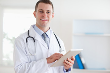Doctor with his tablet