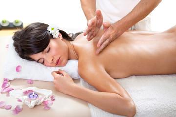 Fresh and Beautiful brunette woman having massage