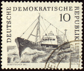 Ship at sea on post stamp