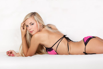 Gorgeous blond fashion model in sexy pink lingerie