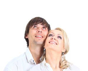 Couple having embraced look afar on a white