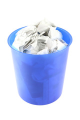 Waste paper in blue plastic trash isolated.