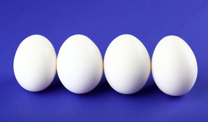 Eggs isolated on purple background