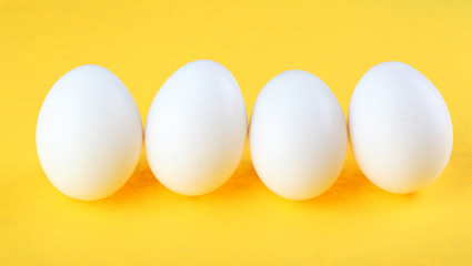 Eggs isolated on yellow background