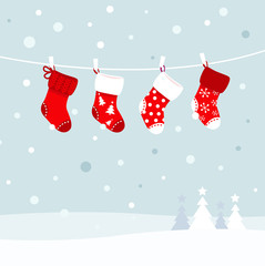 Christmas stockings in winter nature - white and red..