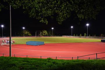 Athletes night training in floodlight stadium