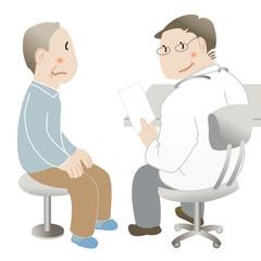 医師の診察を受ける高齢男性