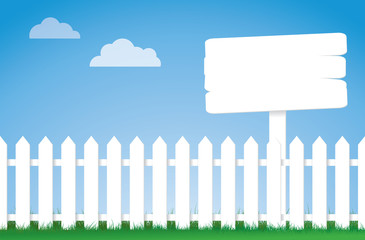 white picket fence with a sign
