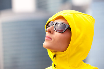 girl in a yellow hood