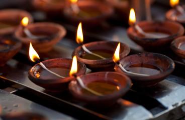Candles at Shwedagon Paya Pagoda in Yangon, Myanmar