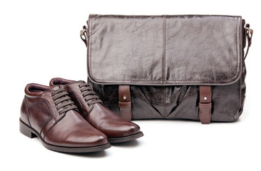 Pair of men boots and messenger bag over white