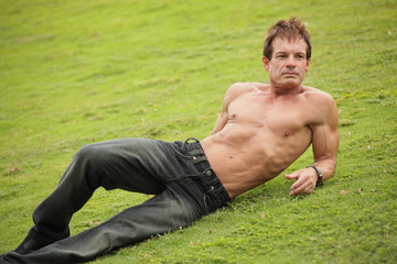 Handsome man laying on the grass