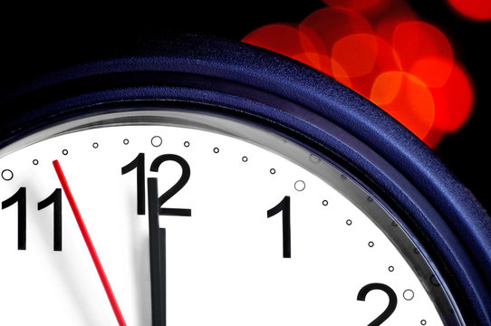 Office clock about to show midnight - few seconds to New Year