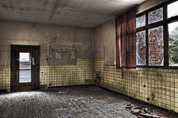 Fotobehang Nepal Empty room with broken window and yellow tiled wall in an abando