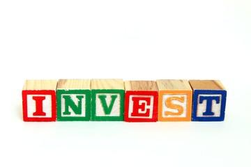 The word invest in alphabet blocks