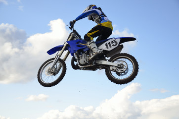 High flight of motocross racer on a motorcycle