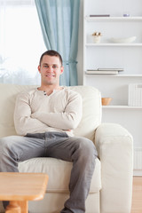 Portrait of a man sitting on a couch