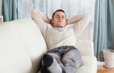 Young man resting on a sofa