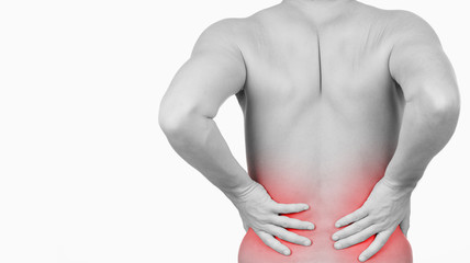man showing that he has pain in his back