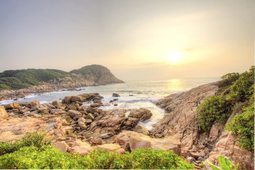 Sea stones along the coast at sunrise
