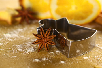 Star anise with angel shaped cookie cutter on dough