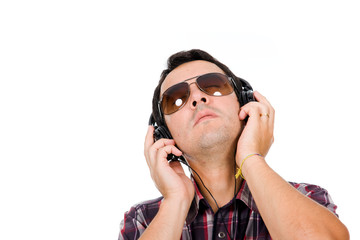 young man listening music with headphones against white backgrou