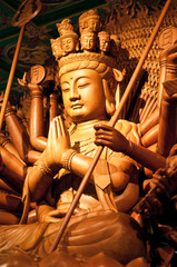 Thousand hands wooden Buddha in temple,Thailand